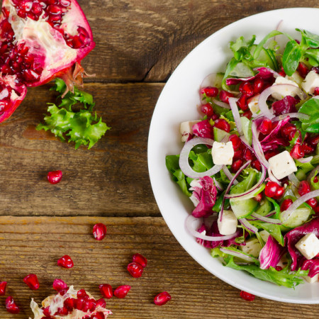 Fresh healthy salad with feta and pomegranate.